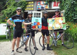 DSC_0002_03.JPG Pedel to the Metal. A group of BackRoads Touring cyclists stopped in to the Painted Saltbox to preview the new metal prints