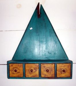 Triangular wall cupboard